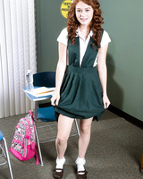 Cute redhead Alice Green strips out of her schoolgirl uniform