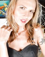 Tattooed European babe Alina Long showing off sexy MILF butt