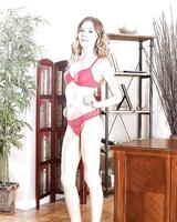 Blonde secretary Allison Faye stripping down to bra and panties