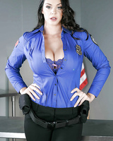 Chesty brunette Alison Taylor removing police uniform for nude photos