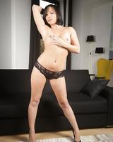 Brunette MILF Alysa Gap takes off her dress and pretties before masturbating