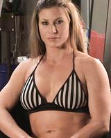 Bodybuilders Ariel X and Mistress Kara wrestle while wearing sexy bikinis