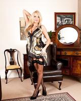 Blonde MILF Amber Rayne posing topless in stockings and garters