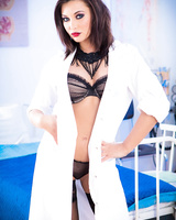 Brunette nurse Anna Polina in stockings strips off her uniform for the camera