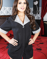 Jynx Maze wears high heels while displaying her goods in a hotel room