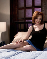 Natural redhead Audrey Hollander flaunts her big tits in the nude