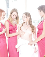 Bridesmaids in pink dresses engage new bride in an all girl orgy