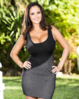 Brunette housewife Ava Addams bares her huge tits as she strips naked