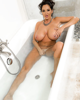 Ava Addams is joined by Megan Rain in the bathtub for a lesbian session