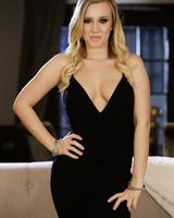 Blonde female Bailey Brooke takes off her black dress for nude modeling gig