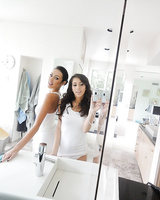 Latina lesbians April Oneil and Breanne Benson take naughty mirror selfies