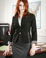Posing scene in the office features sexy redhead Bree Daniels