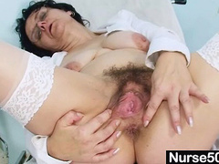 Awesome mature nurse examines pussy with big tools