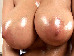 Hot oiled bitch gets her huge jugs and pussy rubbed