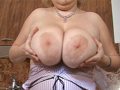 Mature whore plays with her huge jugs just for you