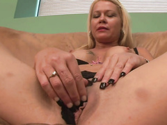 Curvy cougar strips and teases meaty tight pussy