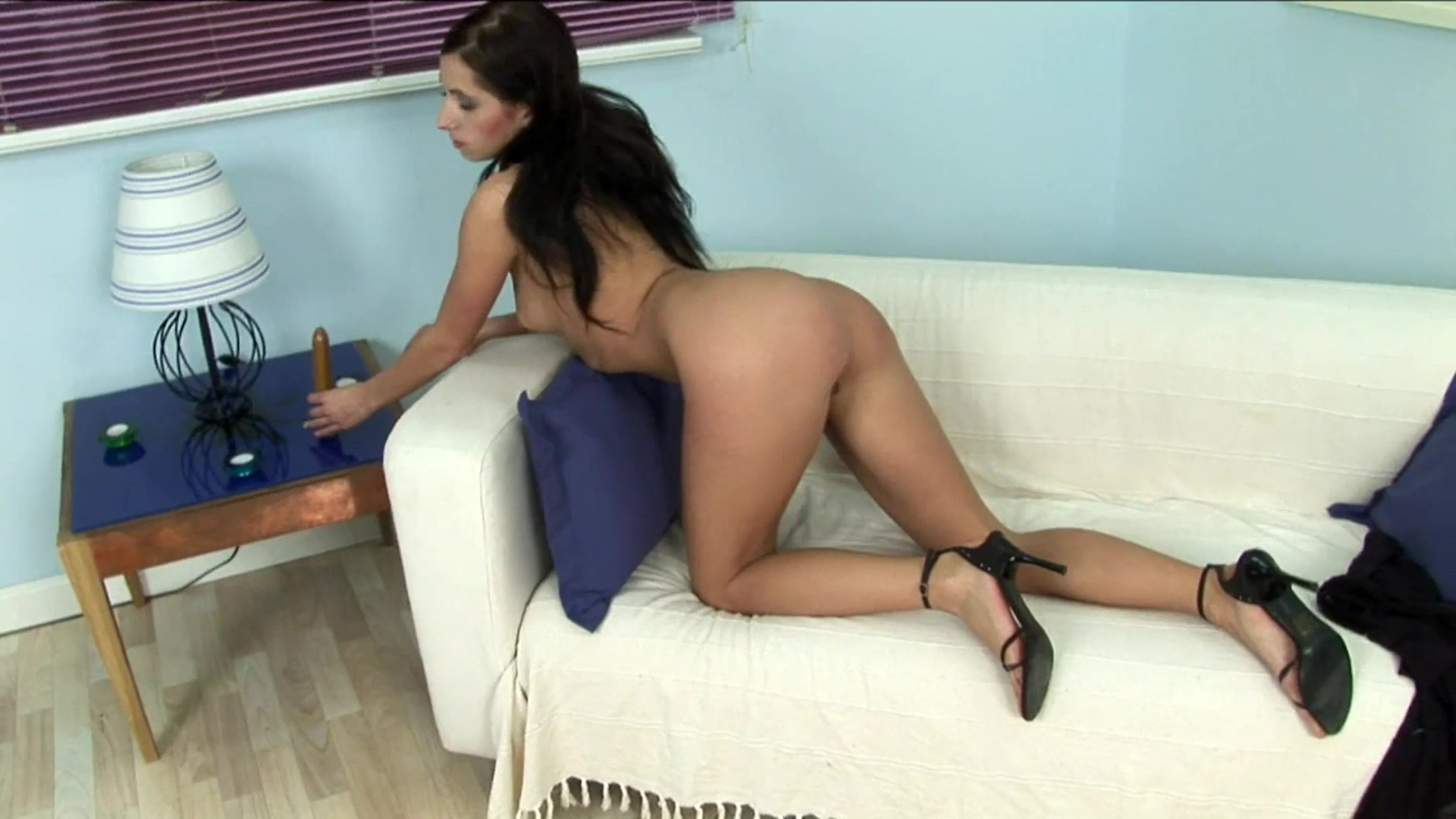 Brunette has great time with chocolate color dildo