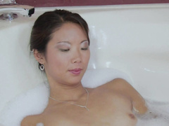 Naked Asian lady plays with her snatch in bath tube