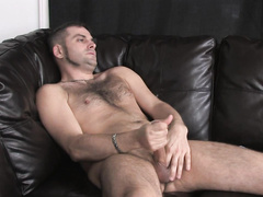 Haired buddy uses his right hand to receive pleasure