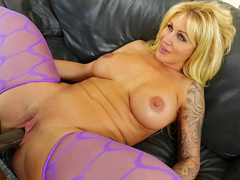 Ryan Conner lies on the couch and big black dick stretches tight cunt