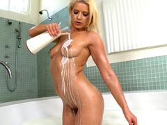 Blonde lovely Anikka Albrite pours gorgeous body with milk in bathtub