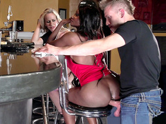 Diamond Jackson casually chats with Simone Sonay while the bartender fucks her ass
