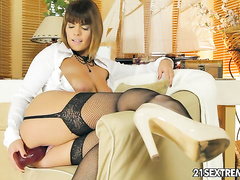 Sandra Cox eases a dildo, and fingers her pussy and ass