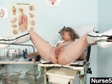 Kinky mature whore hard masturbates in gyno chair