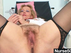 Hot mature bitch shows off furry twat on gyno chair