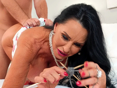 Mature Rita Daniels knits while getting fucked doggy style