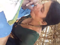 Indian MILF Sex Giving Her Horny Lover Outdoor Blowjob
