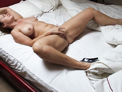 Married woman in heels masturbates on the bed waiting for XXX buddy