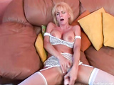 Busty mature whore Houston rubs clit and toys pussy